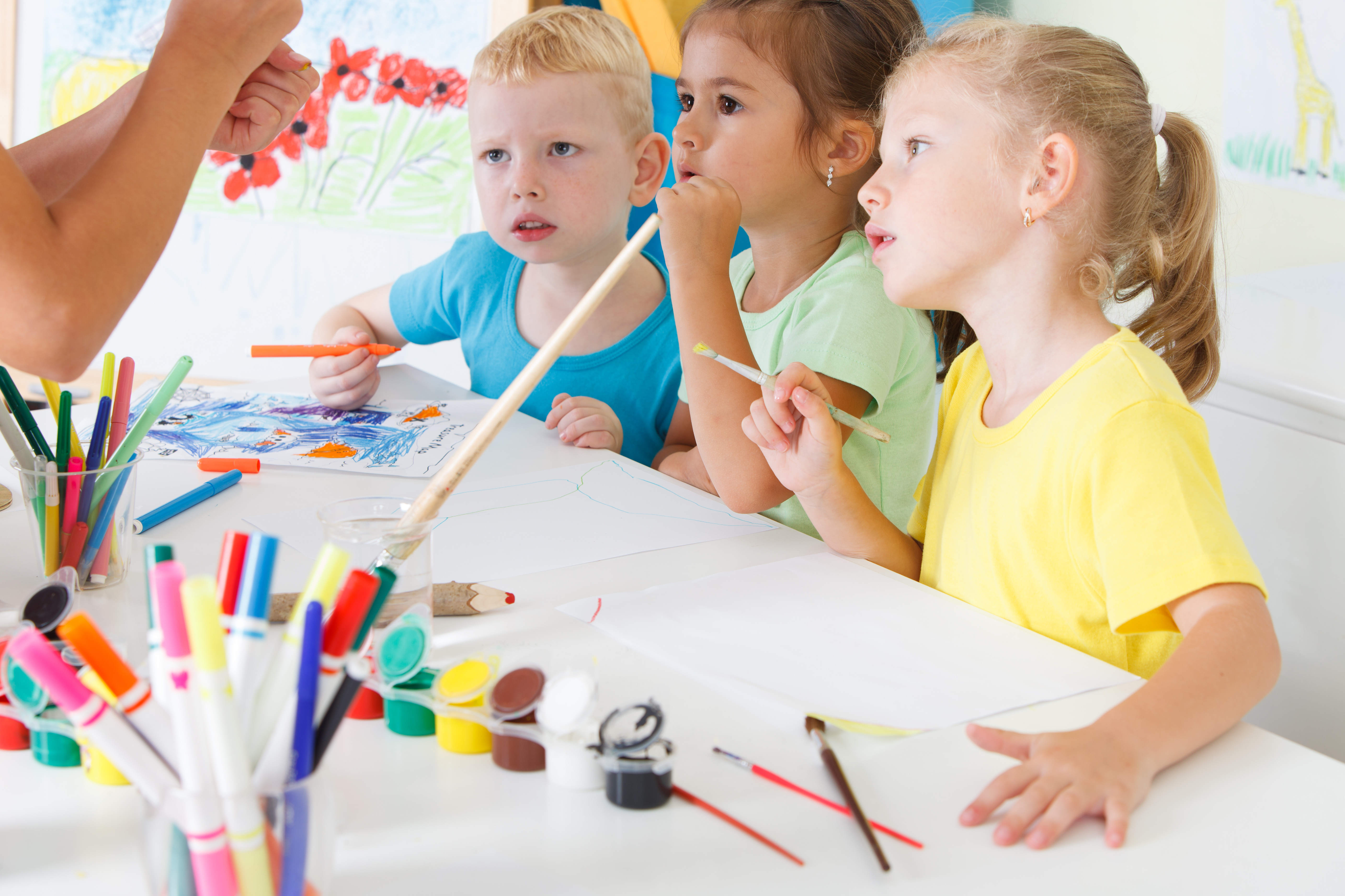 Children draw in the classroom