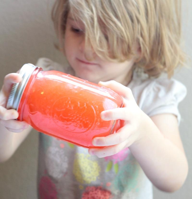preschooler mixing oil and water