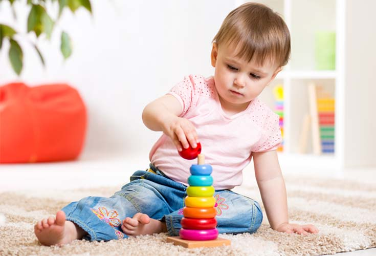 young child stacking